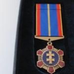 """""""Lėtieji"""" estai Lietuvos policijai gamina uniformų sagas, kepurių ženklus ir ženklus """"Už nepriekaištingą tarnybą"""""""
